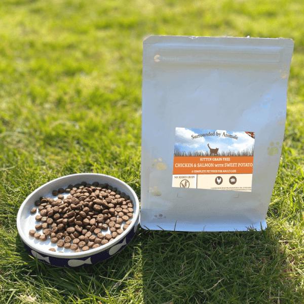 400g bag of grain free kitten food next to a bowl of kibble