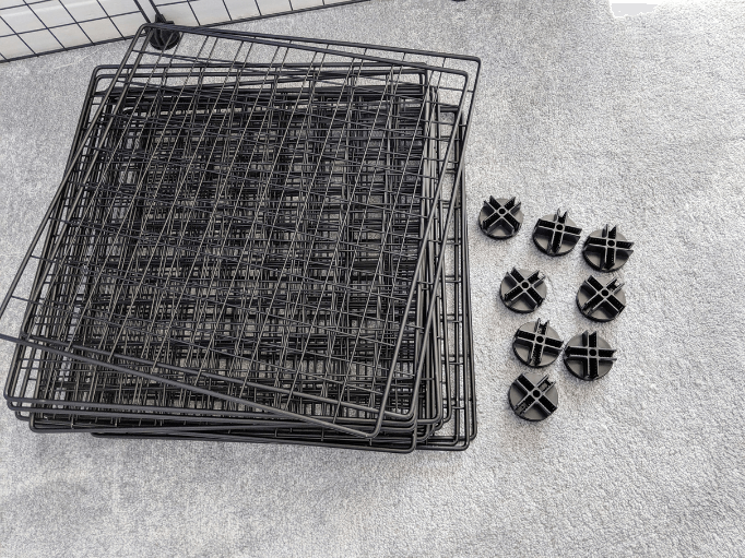 a pile of grids and some connectors to build a c & c cage
